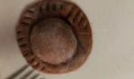 Коричневые равиоли с орехами